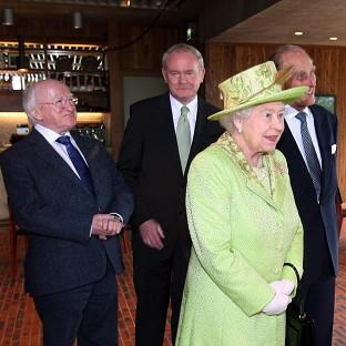 Martin McGuinness, centre, will attend a state banquet at Windsor Castle hosted by the Queen, during an official v