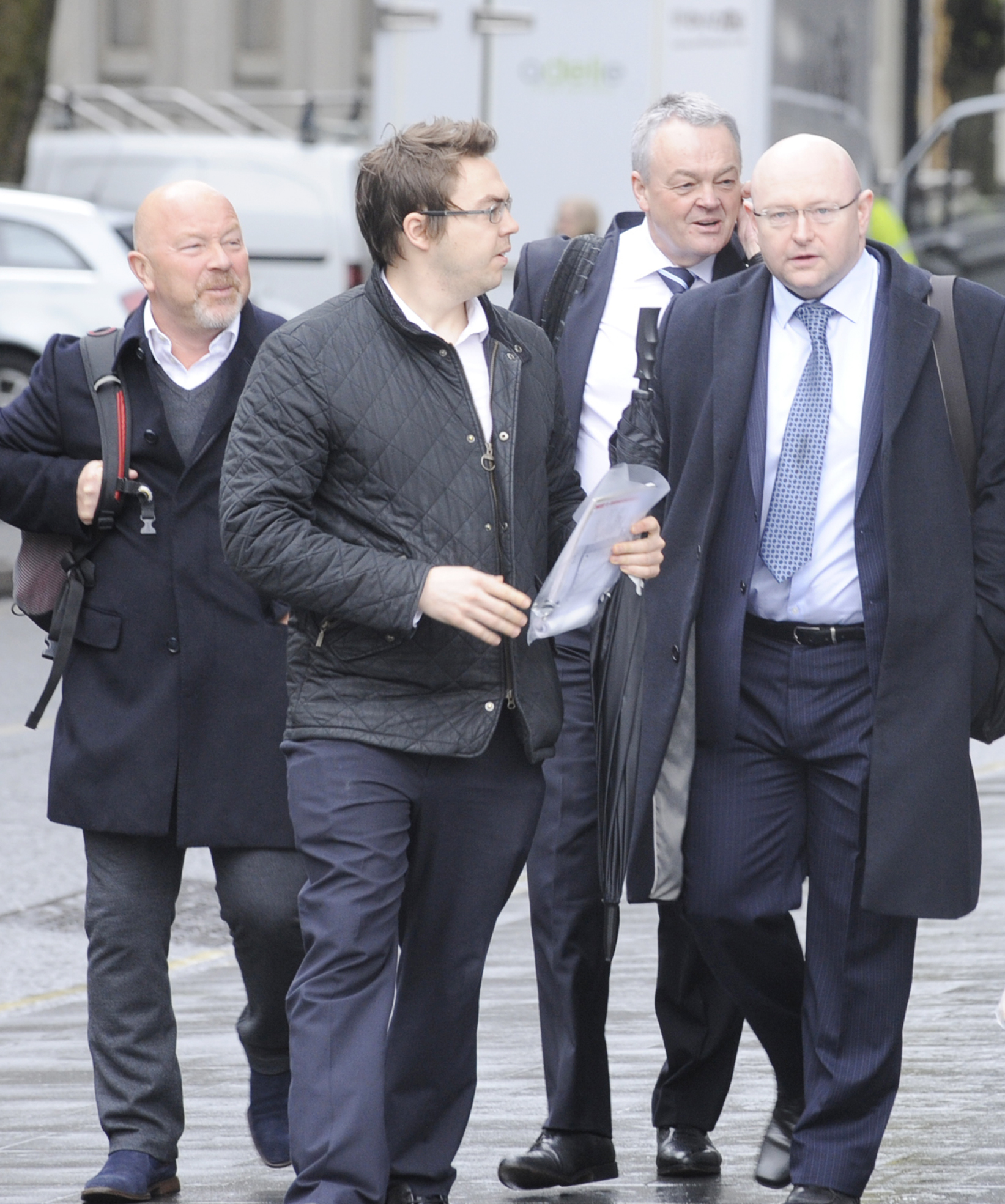 Frank McParland, left, and Phil Gartside, second from right, among a group of men arriving at court
