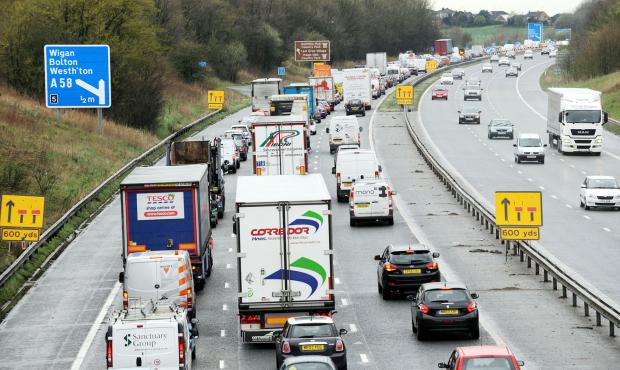 This Is Lancashire: Traffic congestion on M61 at Four Lane Ends