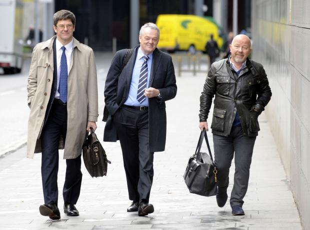 Phil Gartside, centre, entering court with Fr