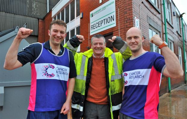 Runners Lee Swales, left, and Max Halsall with their boss Steve Collinson, outside the reception of Fairport Containers