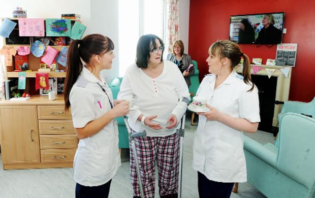 Dawn Fielding, centre, of Whalley, looks over the new day room with health care assistants Jade Osbaldeston and Diane Yates