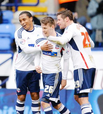 ONE OF THE GANG Joe Mason celebrates after scoring against Watford with Neil Danns, left and Lukas Jutkiewicz