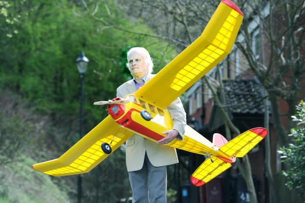 This Is Lancashire: Michael Parkinson faces removal from Pleasington playing fields by police if he flies his model aircraft there in the latest twist to an 18-month dogfight.