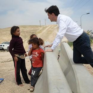 This Is Lancashire: Labour leader Ed Miliband meets children in the Khan al-Ahmar the Bedouin community in the West Bank.
