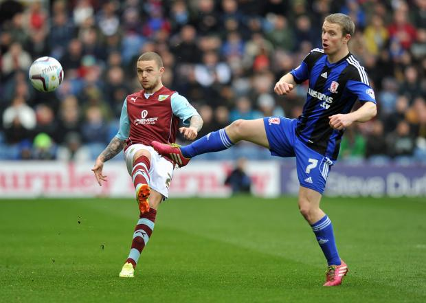 Kieran Trippier clears the danger on his return to the Burnley first team