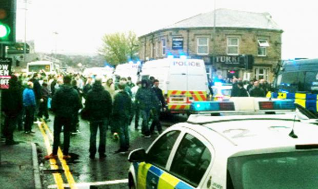 This Is Lancashire: Police outside Turf Moor after the match