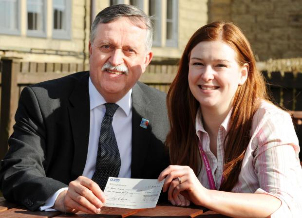 Rotary Club president Alan Smith, pictured left, was on hand to present the hospice's fundraising manager Alice Atkinson, right, with the cheque at the Blundell Arms in Chorley Old Road.