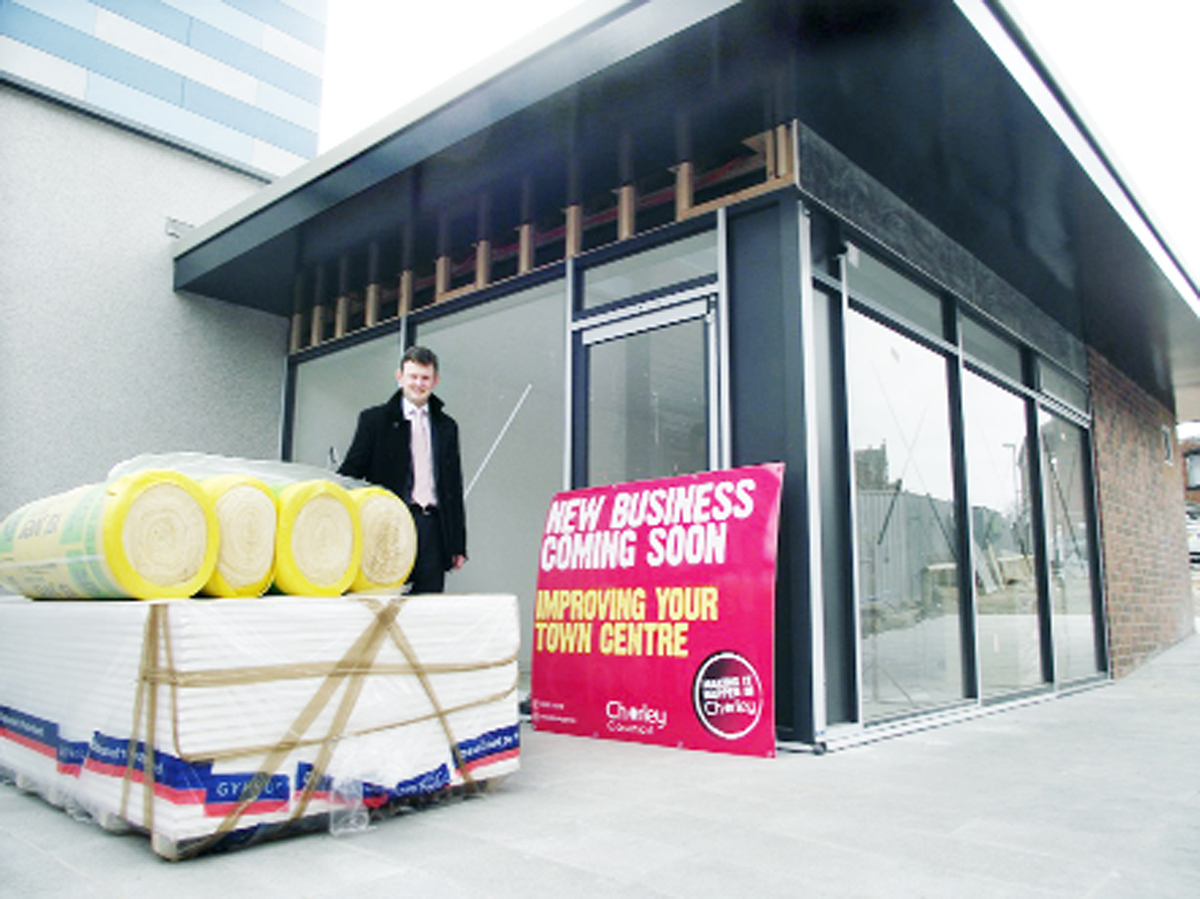 FINISHED: Coun Peter Wilson outside the new retail units on Market Street where work is now complete