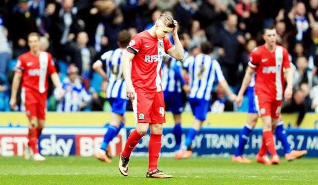 Tom Cairney and Michael Keane rue Sheffield Wednesday's equaliser at Hillsborough