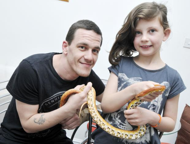 This Is Lancashire: Stuart Smith and his daughter, Kiera, aged nine, reunited with his snake, called Mysterious