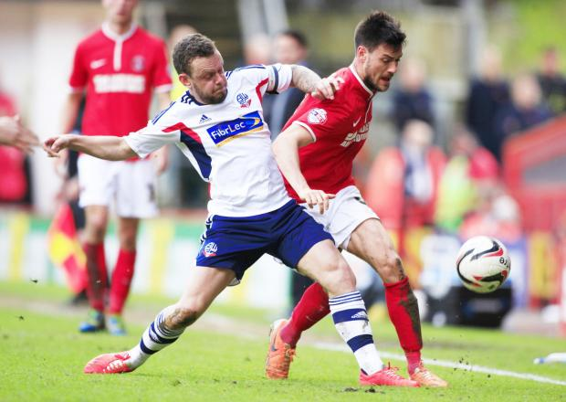 BALL WINNER Jay Spearing, left, tackles Charlton's Johnnie Jackson