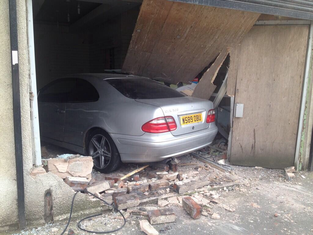 Car crashes into university building