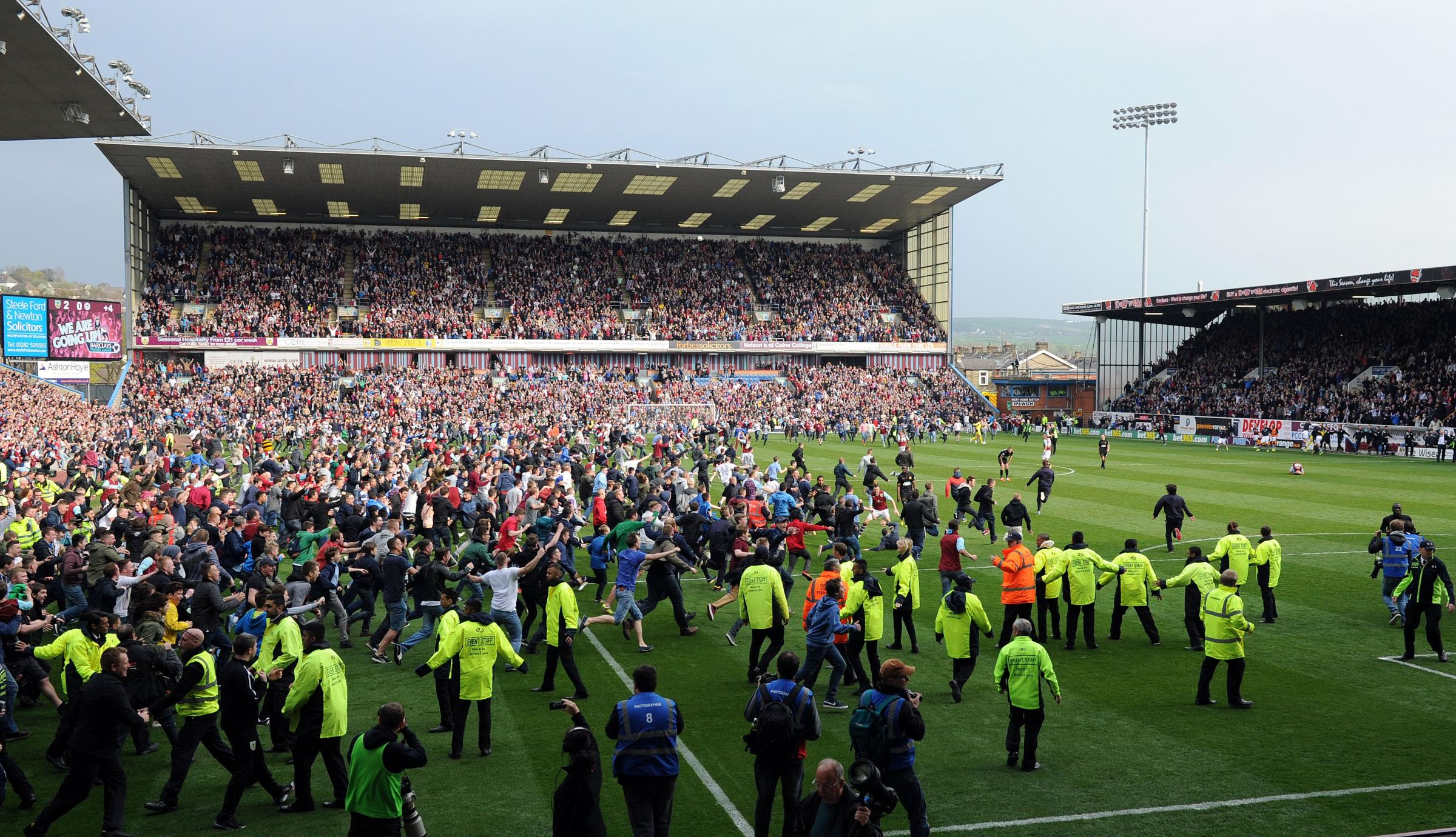 Burnley fans party on the pitch