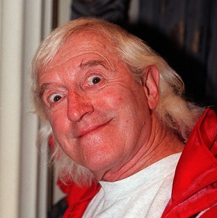 Newspaper ads are telling alleged victims of Jimmy Savile how to claim compensation