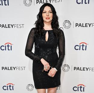 Laura Prepon has denied rumours she is dating Tom Cruise