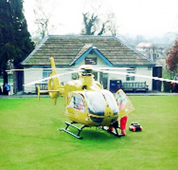 This Is Lancashire: The medics' chopper lands near Clitheroe Castle