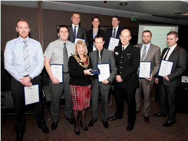 From left, back, Sgt Ian Partington, Det Con Carolyn Morley, PC Nathan Lilley; front row, Det Con Gordon Milne, Sgt Andy Westmoreland, the mayor, Cllr Sharon Briggs, Det Con Dave Potter, former Bury Ch Supt Tim Forber, PC Andy Kiddie and PC Craig Murray