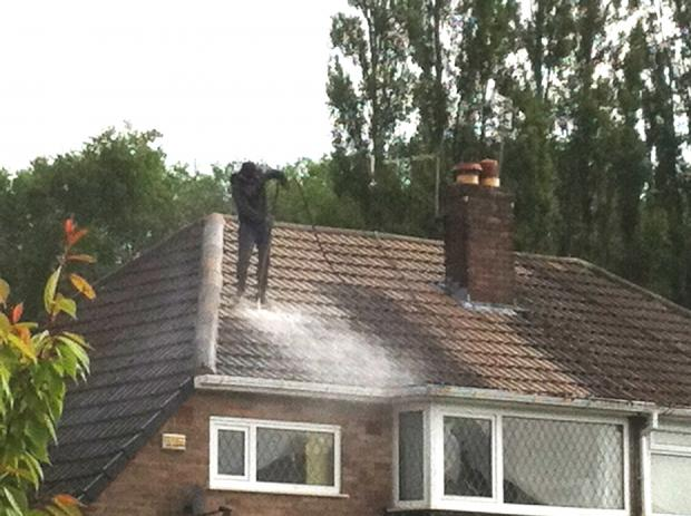 Worker caught standing on slanted roof