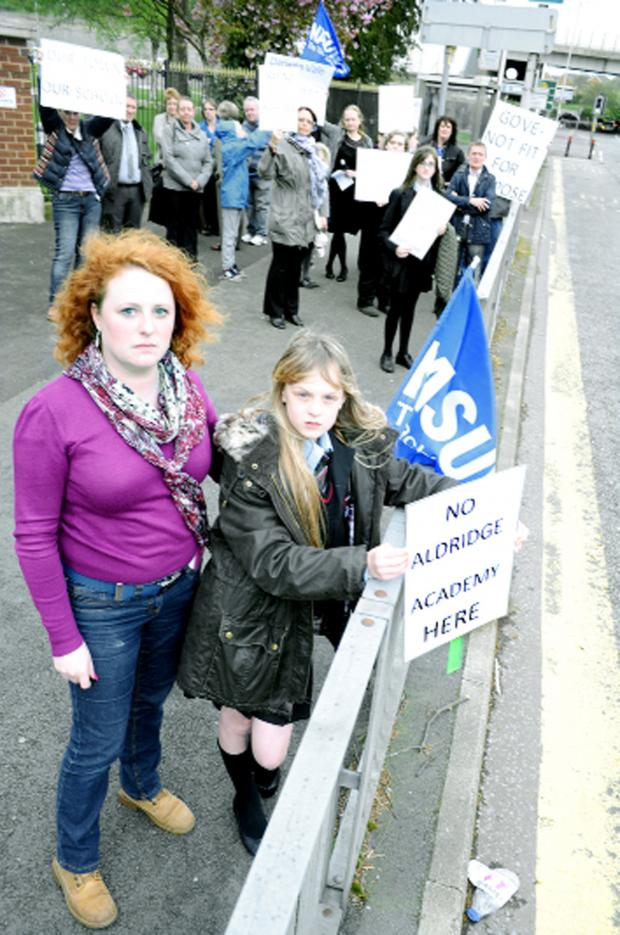 This Is Lancashire: English teacher Claire Ward and Emma Davidson, 12, were among the protesters against academy plans for Darwen Vale High School