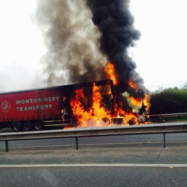 This Is Lancashire: The lorry fire on the M61 this morning. Picture by ‏@BuckshawChorley via Twitter.