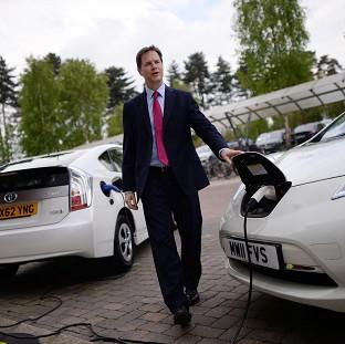 Deputy Prime Minister Nick Clegg charges an electric car during a visit to the Transport Research Laboratory in Berkshire