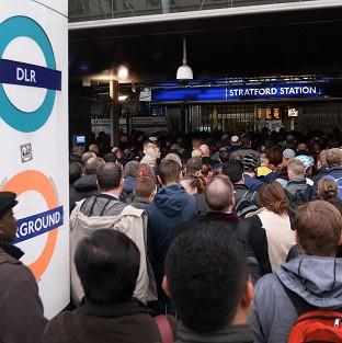 This Is Lancashire: Commuters at Stratford station in east London, on the first day of a 48 hour strike by tube workers