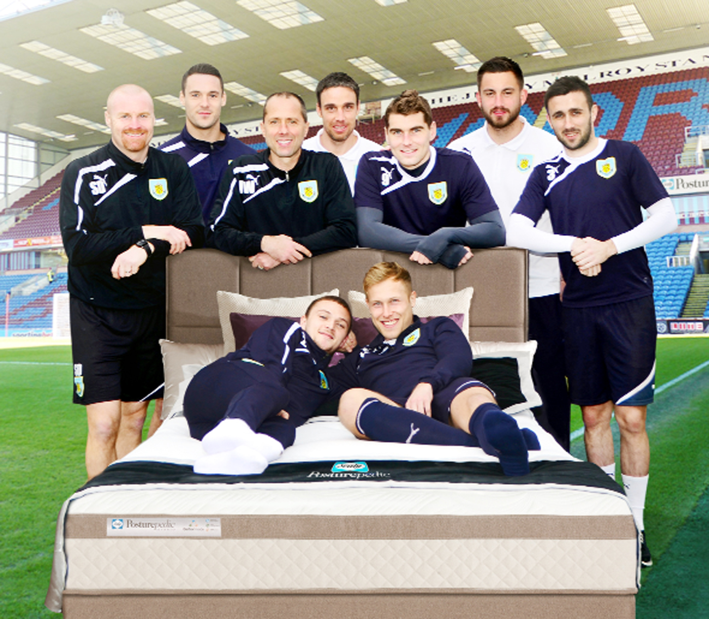Sean Dyche and the Clarets with one of the Sealy beds – a 'unique fusion of memory foam with a new elasticised gel'