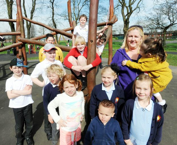 Childminder Catherine Thornley at Whitehead Park with some of her charges