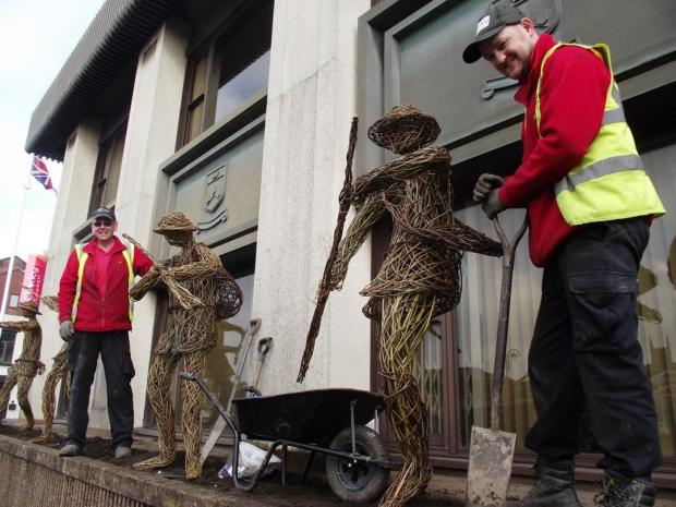 tribute: Chorley Streetscene worker Luke Sweeney installs one of the 'Band of Brothers'