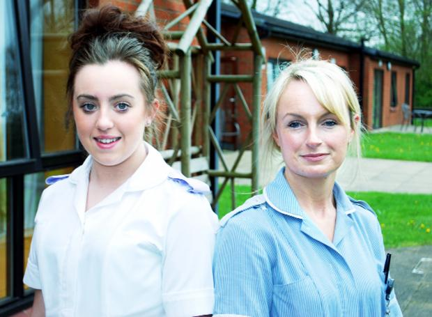 Alice Hegarty (left), on a midwifery placement, a