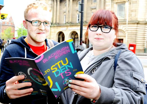 This Is Lancashire: Curtis Baron, 21, and Cassie Bestwick, 18, check out the booklet