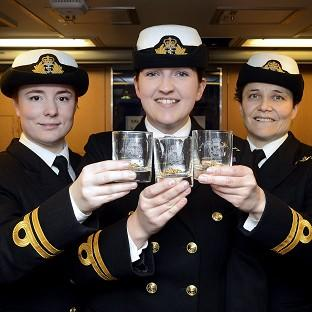 This Is Lancashire: Lieutenants Maxine Stiles, Alexandra Olsson and Penny Thackray who have made history by becoming the first female submariners to serve in the Royal Navy.