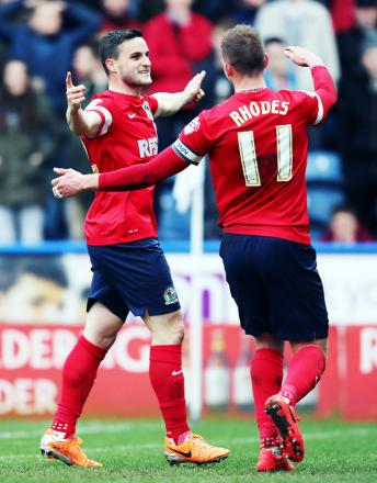 Craig Conway celebrates another Rovers goal with Jordan Rhodes