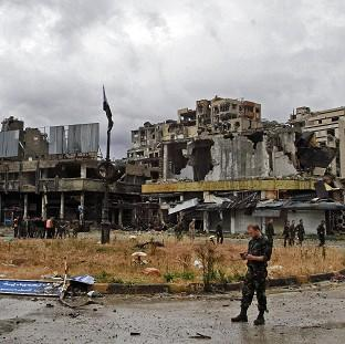 Syrian government forces inspect damage in Homs