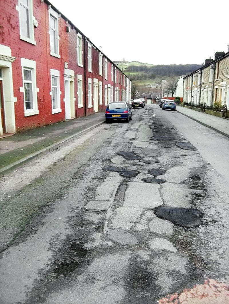 Coun Jim Smith says Powell Street, Darwen, is in line for repairs despite being omitted from the list put before the executive board