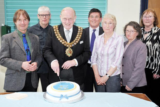 Civic trust executive members at the cake cutting ceremony, from left, Richard Shirrees, Derek Bullock, Cllr Colin Shaw, Mayor of Bolton, Alan Gill, Dorothy Green, Joan Ball and Margaret Collier