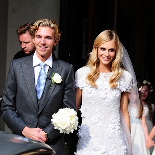 James Cook and Poppy Delevingne after their wedding at St Paul's Church in Kensington