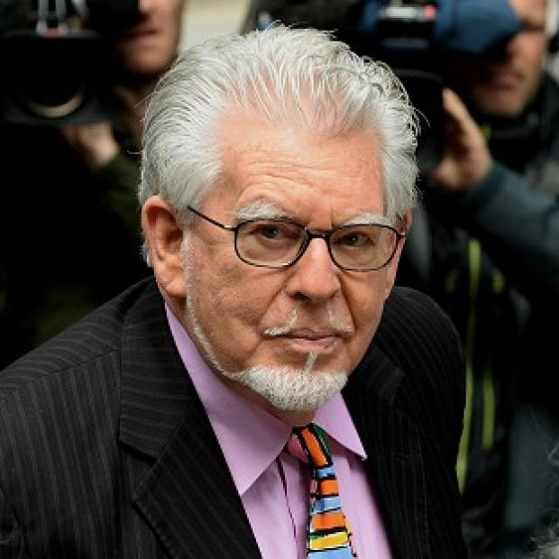 This Is Lancashire: Rolf Harris denies the charges.