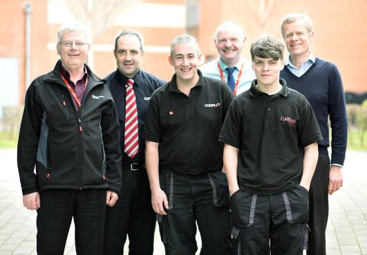 This Is Lancashire: At the talk, from left, college tutor Mick Rutter, Chorley Nissan service manager Jason Slattery, Chorley Nissan's master technician Chris Shearer, college lecturer Gerard Linnane, apprentice Sam Cairns, and college tutor Phillip Waddington
