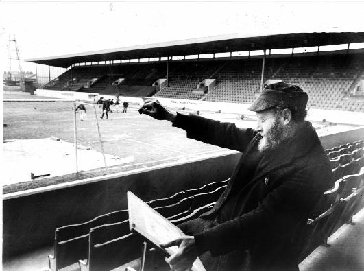 David Wild painting a water colour of Turf Moor in 1978.