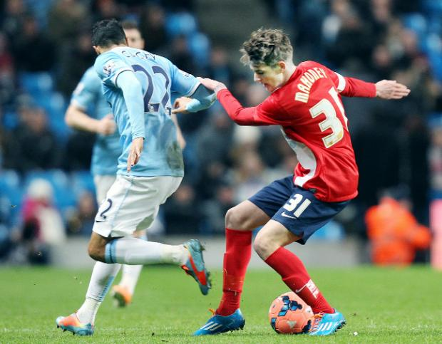 Connor Mahoney in action for Rovers against Manchester City