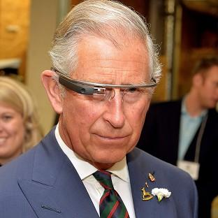 This Is Lancashire: The Prince of Wales tries on Google Glass on the final day of his trip to Canada.