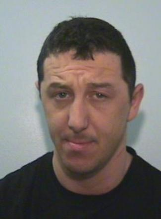 Lee Hall., aged 31, is wanted for harassment in Whitefield