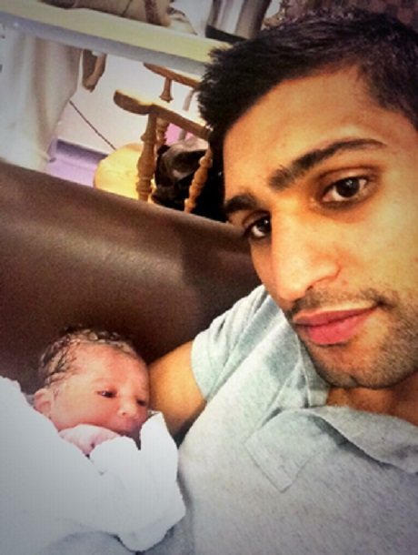 Amir Khan with his newborn baby Lamysah Khan - not Lamysa any more.