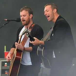 This Is Lancashire: Chris Martin (right) of Coldplay performing with The Kings of Leon during Radio 1's Big Weekend at Glasgow Green, Glasgow.