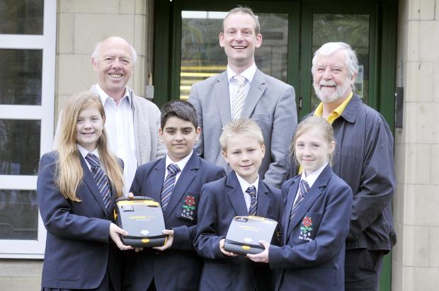 This Is Lancashire: Pupils Annabel Hartley, Baha Javed, Liam Whittle, and Sophie Snell with Jack Rogerson, headteacher Adrian Calvert and Geoff Hall from Elton CC