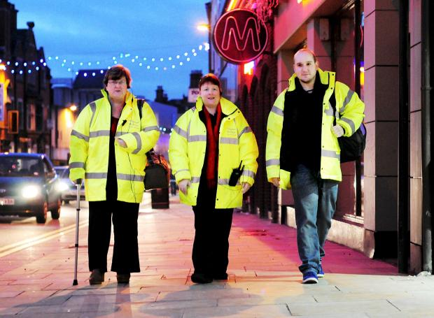 From left, Street Angels Jackie Harrison, Suzanne McKinley and Scott Gildea