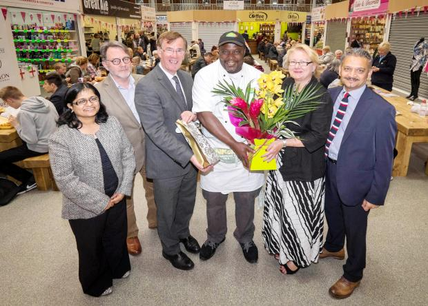 From left, Sufrana Bashir-Ismail, Keith Burnett, Graham Wilson, Alain Jobe, Hilary Paxman and Malcolm Vegas at the Lifestyle Hall in Bolton Market