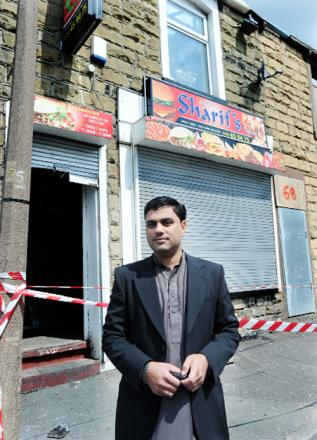 Zahid Sharif outside his gutted takeaway